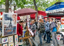 Tourists visiting Place du Tertre in Montmartre, Paris, France Royalty Free Stock Photography