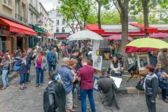 Tourists visiting Place du Tertre in Montmartre, Paris, France Stock Photo
