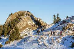 Tourists visiting Postavaru Peak, Romania Royalty Free Stock Images