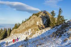 Tourists visiting Postavaru Peak, Romania Royalty Free Stock Image