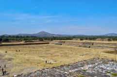 Tourists visiting the pyramid of the feathered serpent in Teotihuacan royalty free stock photos