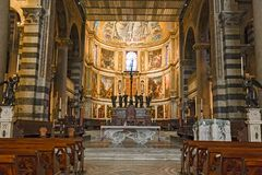 Tourists visiting the Renaissance Cathedral of Pisa in the squar. PISA, ITALY - NOVEMBER 29, 2015: Tourists visiting the Renaissance Cathedral of Pisa in the Stock Image