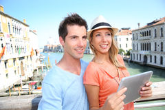Tourists visiting Rome with help of tablet Stock Image