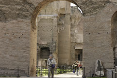 Tourists visiting Rome ruins stock images