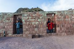 Tourists visiting the ruins of Pisac stock photography