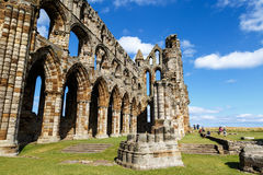 Tourists visiting the ruins of Whitby Abbey Royalty Free Stock Photo
