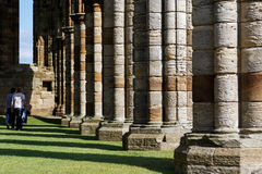 Tourists visiting the ruins of Whitby Abbey Royalty Free Stock Image