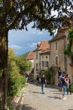 Tourists Visiting Saint-Cirq-Lapopie In France Royalty Free Stock Image