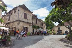 Tourists Visiting Saint-Cirq-Lapopie In France Stock Image