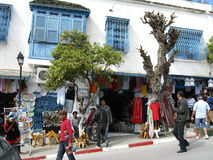 Tourists visiting Sidi Bou Said. In Tunisia. Blue and white buildings are major tourist attraction in Sidi Bou Said in Tunisia, with markets noted for selling Royalty Free Stock Image