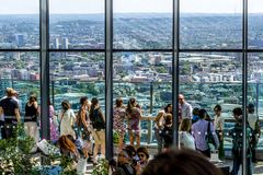 Tourists visiting, Sky Gardens in London, panorama of London seen from above. 03.07.2018. United Kingdom stock photo