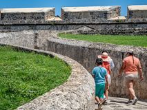Tourists visiting a Spanish-colonial style fortified structure i stock photography