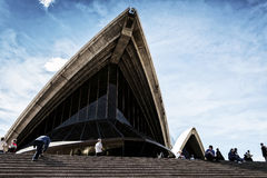 Tourists visiting sydney opera house in australia on sunny day Royalty Free Stock Image