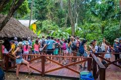 Tourists visiting Tayrona National Natural Park in Royalty Free Stock Photo
