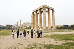 Tourists visiting Temple of Zeus Stock Photo
