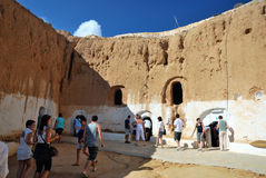 Tourists visiting Troglodyte house Royalty Free Stock Photo