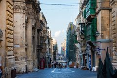 Tourists visiting Valletta city. VALLETTA, MALTA - AUGUST 21, 2017: Tourists walking in Valletta city and enjoying a plenty sunny afternoon in the historical Stock Photography