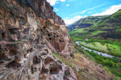 Tourists visiting Vardzia ancient cave city on a spring day in May. Vardzia is one of the main attraction in Georgia Royalty Free Stock Photo