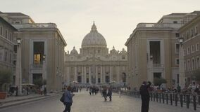 Tourists visiting Vatican City in Rome, view from Road of Conciliation, slow-mo. Stock footage stock video footage