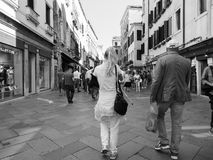 Tourists visiting Venice in black and white Stock Photo