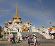 Tourists visiting Wat Trimit (Golden Buddha temple) in Bangkok Stock Photography