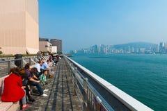 Tourists and visitors along Kowloon Promenade, Hong Kong, China Royalty Free Stock Image