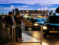 Tourists and visitors of Barcelona waiting for the taxi car stock photos