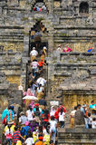 Tourists and visitors climbing steps of Borobudur Royalty Free Stock Photo