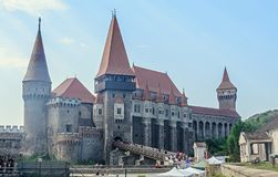 Tourists visits the Corvins Castle build by John Hunyadi. Royalty Free Stock Images