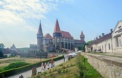 Tourists visits the Corvins Castle build by John Hunyadi. Stock Photography