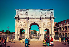 Tourists visits the famous Arch of Constantine in Rome, Italy Stock Photo