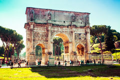 Tourists visits the famous Arch of Constantine in Rome, Italy Stock Images