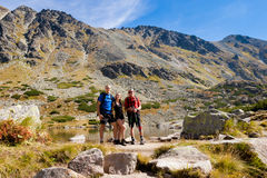 Tourists in Vysne Kozie pleso Royalty Free Stock Photography