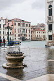Tourists wait bus on square in Venice in rain Stock Photo