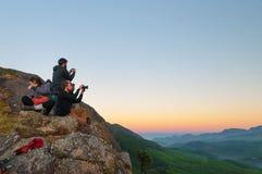 Tourists wait for sunrise on Devikulam hill. Munnar Royalty Free Stock Photo