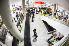 Tourists wait for their baggage at Royalty Free Stock Photography