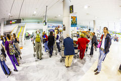 Tourists wait for their baggage at Stock Image