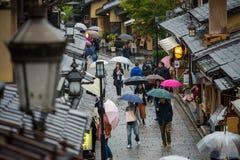 Tourists waiting in ancient walking street near Kiyomizu temple Royalty Free Stock Photo