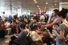 Tourists waiting delayed flight Istanbul, Ataturk Airport Stock Photography