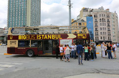 Tourists waiting departure of Big Bus Istanbul Tour Bus at Taksim Square Stock Photography