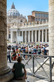 Tourists waiting for entrance in st Peter's basilica. A tourist patiently waiting and watching a large crowd in front of Saint Peter's cathedral. Summer 2013 Stock Images