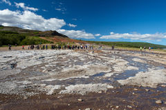 Tourists waiting for the eruption of geysir, Iceland Royalty Free Stock Image