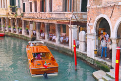 Tourists waiting for landing on a pleasure boat in Venice, Italy Stock Images