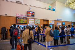 Tourists waiting in line for purchase Sagano romantic train Stock Photography