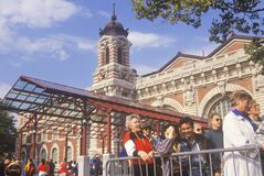 Tourists waiting in line to visit Ellis Island National Park, New York City, New York Royalty Free Stock Images