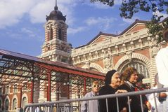 Tourists waiting in line to visit Ellis Island National Park, New York City, New York Stock Images
