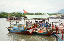 Tourists waiting at the pier for boarding to boat Stock Photo