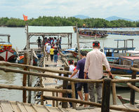 Tourists waiting at the pier for boarding to boat Royalty Free Stock Photo