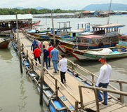 Tourists waiting at the pier for boarding to boat Stock Image