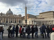 Tourists waiting in a queue to enter Saint Peter basilica in Vatican Stock Photos